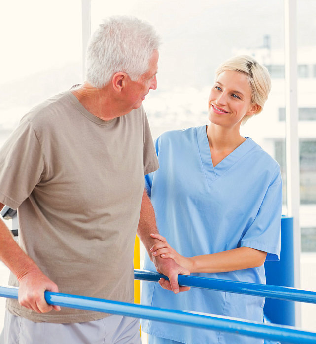 caregiver assisting her patient undergo therapy