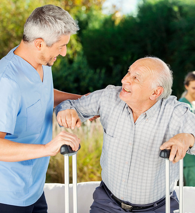 caregiver assisting her patient undergo balance therapy