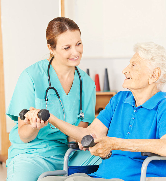 caregiver assisting the patient in doing exercise