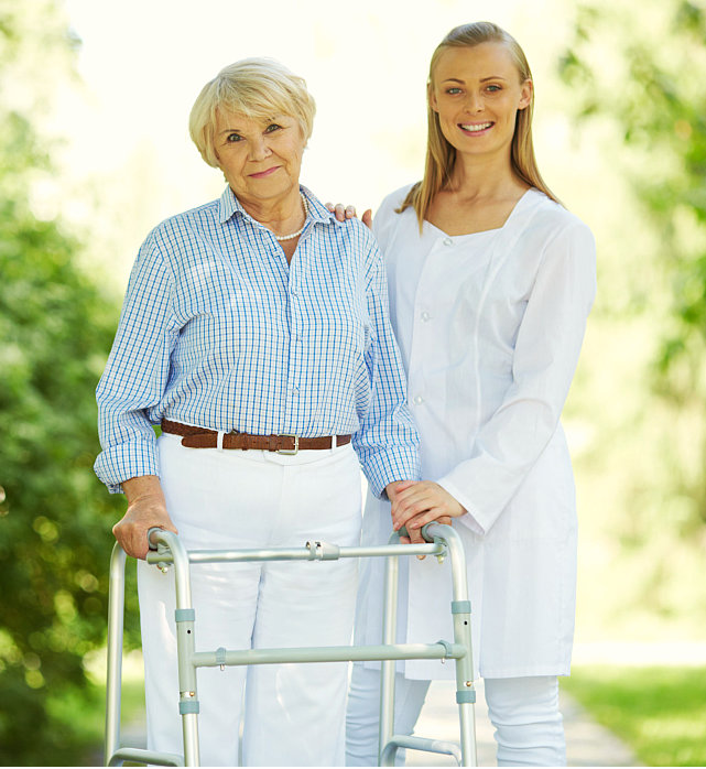 caregiver accompanying her patient in walking
