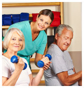 caregiver assisting the patients doing exercise