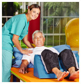 caregiver assisting the patient doing exercise